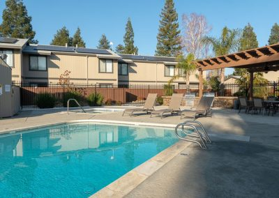 Almondwood Apartments rental pool, bbq, and spa