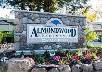 Almondwood Apartments in Davis building sign