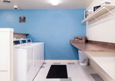 Almondwood Apartments Washing Machines and Workspace