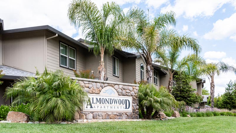 Photograph of Almondwood Apartments Sign viewed from Sycamore Rd